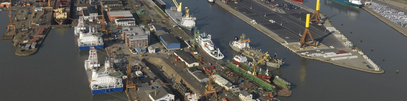 Aerial view of ships, harbors and containers.