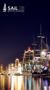 Illuminated sailing ships in the New Harbor left and right along the harbor basin.