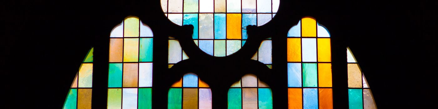 Colorful slices in a church window.