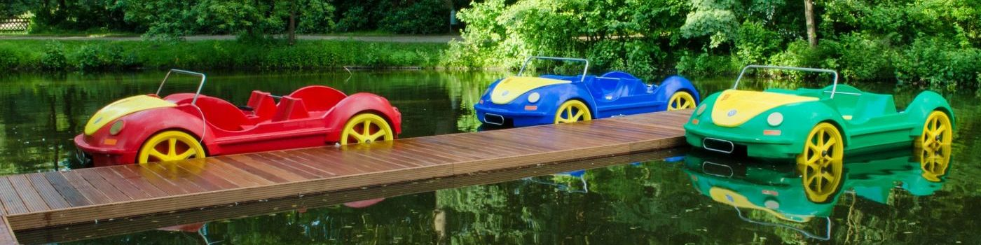 Pedal boats look like cars lie on a mooring.