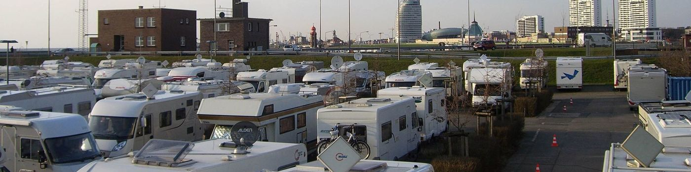 Motor Homes standing in a parking lot.