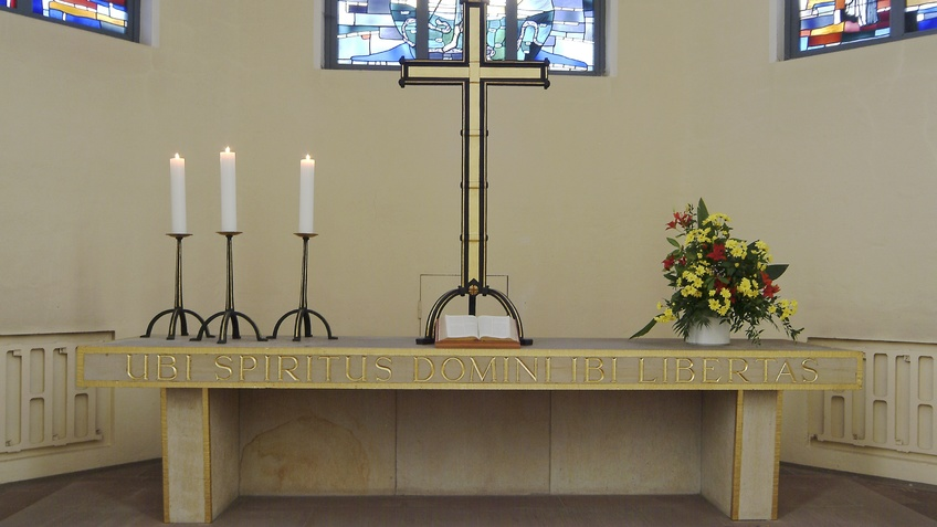 An altar with cross and candles.