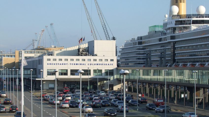 Cruise terminal with parking areas and a cruise ship.