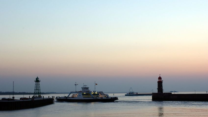 A ferry at sunrise.