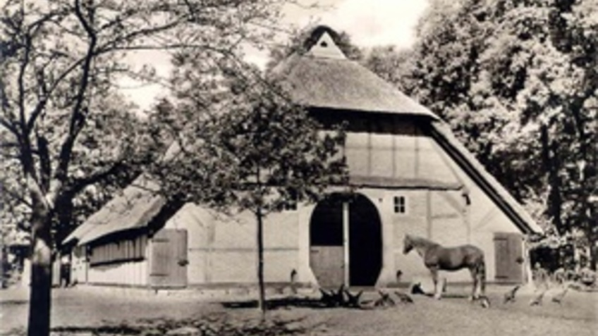 Historical image of a farmhouse.