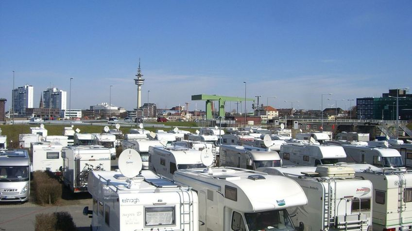 Mobile homes in a parking lot.