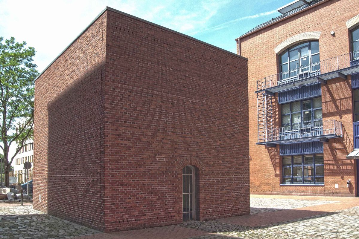 A Rectangular Building Made Of Red Brick