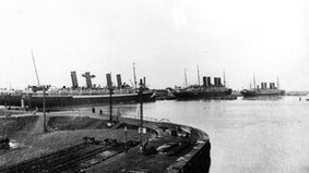 A steamer in a harbor.