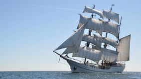 A sailing ship with set sails.