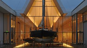 A ship as an exhibition object in a building.