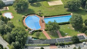 Aerial photo of an open-air swimming pool.