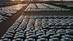Many cars are in rows.