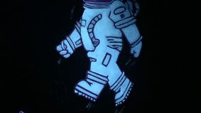 Spaceman figure on black background.