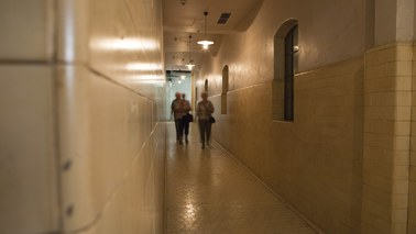 Three People walk in a corridor