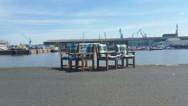 Chairs stand on the quay.