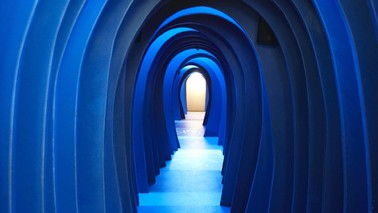 View of a blue colored corridor