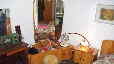 Vanity with table and mirror.