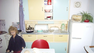 A kitchenette in the 50s style with table and chairs.
