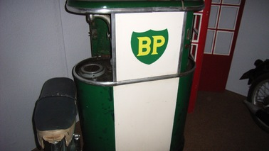 Petrol pump with the initials BP in yellow on a green background.