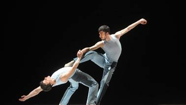 Two men dancing on a stage.