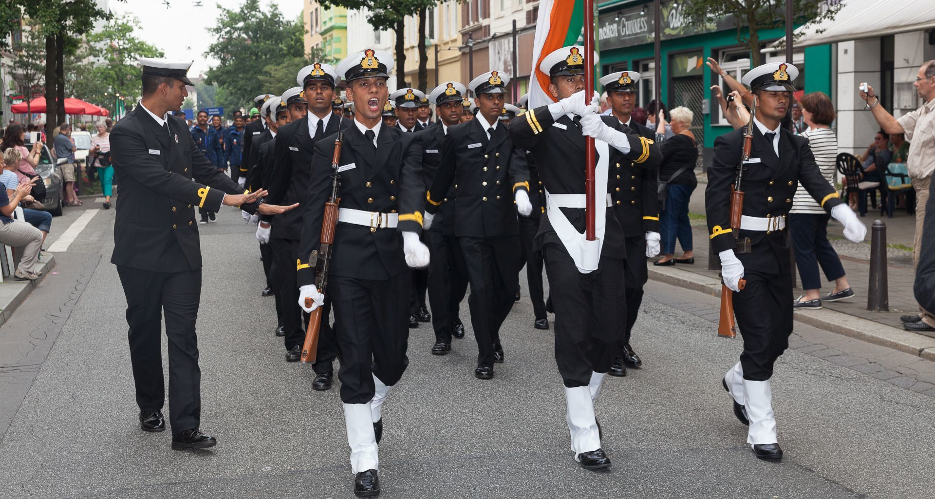 Seamen march through a pedestrian zone.